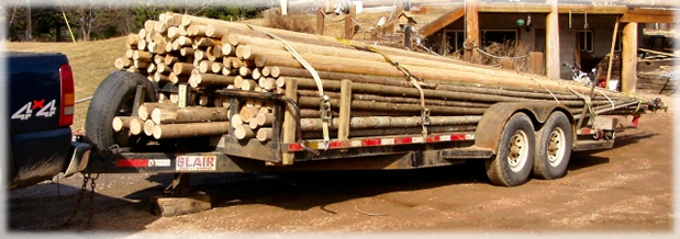 Our high quality, hand made poles, stacked and ready to ship in a custom tipi trailer.